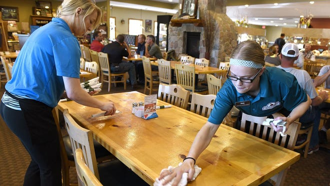 Waitresses Kalley Wolbeck and Amy Mechaelsen clear and prep a table during lunch at the Cornerstone Buffet & Restaurant in Melrose. Cornerstone opened a Sartell location Nov. 23.