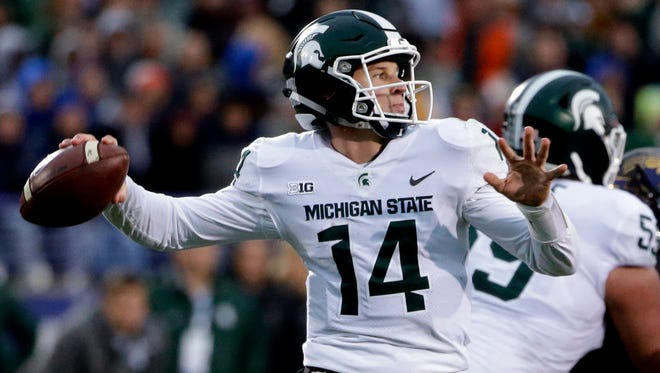 Michigan State quarterback Brian Lewerke looks to pass against Northwestern during the second half of an NCAA college football game in Evanston, Ill., Saturday, Oct. 28, 2017.