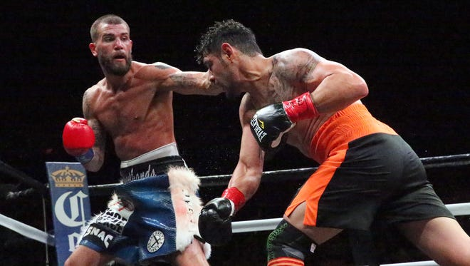 """Caleb """"Sweet Hands"""" Plant, left, of Nashville, fights Porky Medina of San Luis, Mexico, in February 2018 in the Don Haskins Center. Plant won the bout by unanimous decision."""