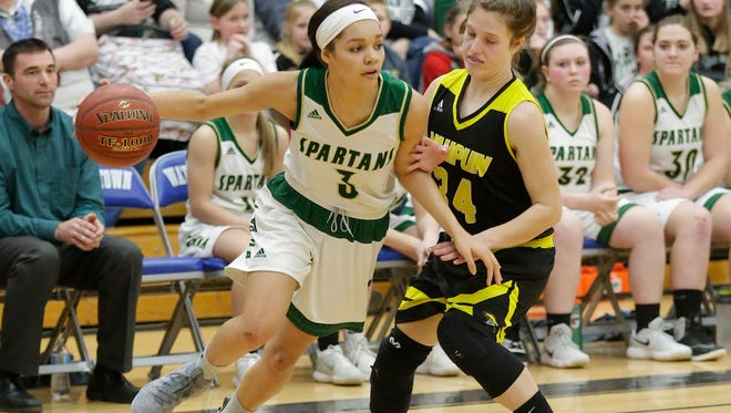Laconia High School girls basketball's Kiarra Otto drives around Waupun High school's Jacey Davis Thursday March 1, 2018 during their Division 3, sectional semi-final game in Watertown. Laconia won the match up 52-40. Doug Raflik/USA TODAY NETWORK-Wisconsin