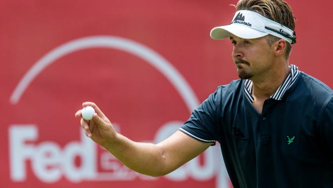 Rikard Karlberg of Sweden acknowledge the crowd during the opening round of the CIMB Classic golf tournament in Kuala Lumpur, Malaysia, in Kuala Lumpur, Malaysia. He leads after shooting a 65.