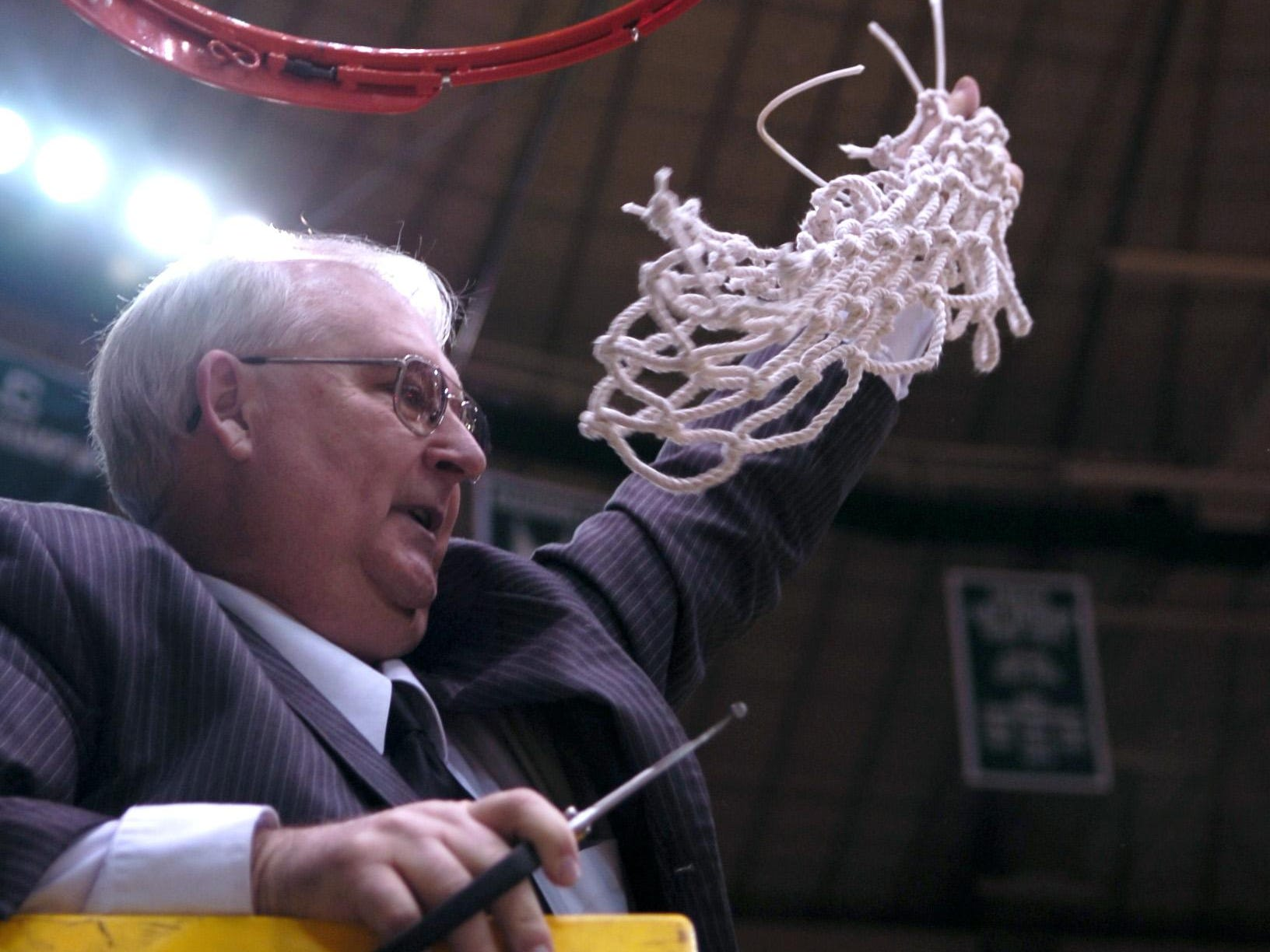 Then-Chillicothe coach Gary Kellough waves the net after the Cavaliers' win at Ohio University's Convocation Center in 2008 that sent them to the Final Four and eventual state championship.