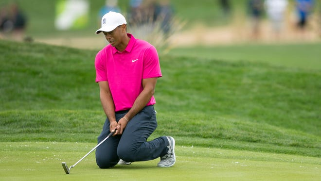 Tiger Woods reacts to missing a putt on the 12th hole during the first round of the 2015 Waste Management Phoenix Open at TPC Scottsdale.