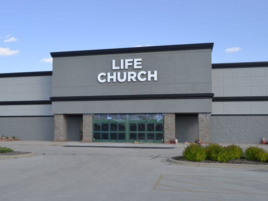Life Church Green Bay held its first Sunday morning services in the former Sportsman's Warehouse retail store at 1551 Lawrence Drive in De Pere on June 12, 2016.