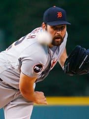 Tigers pitcher Michael Fulmer throws against the Rockies