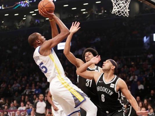 Warriors_Nets_Basketball_83143.jpg