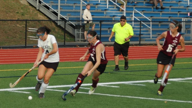 Briarcliff's Sarah Bianco, left, dribbles the ball down the sideline, with Ossining's Alicia Sanchez defending on Tuesday. Zoe Supina, right, looks on.