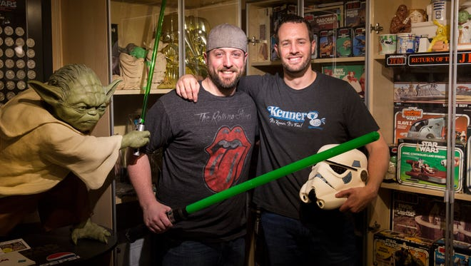 Brothers Ryan, left, and Sean Lehmkuhl have been collecting Star Wars memorabilia since they were kids. They now have one of the largest collections in Ohio, with more than 7,000 items. And it continues to grow.
