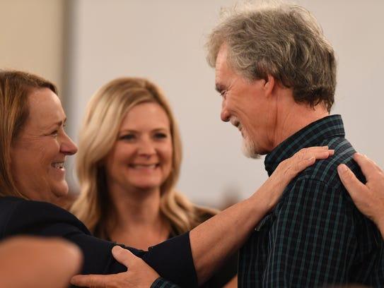 State prosecutor Jennifer Nicols and Dana Bobo, father