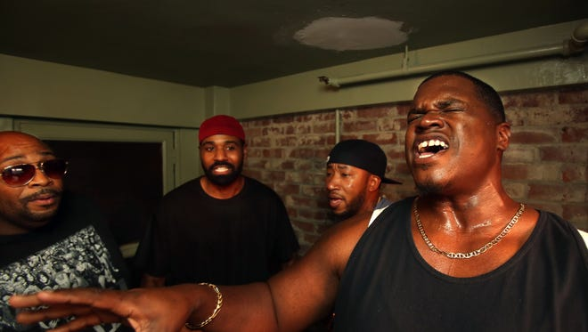 Linkin' Bridge rehearses in a stairwell of a downtown apartment complex. From right to left are Big Rome Kimbrough, Shon China Lacy, Ekoe Alexanda and Monte Davis. 