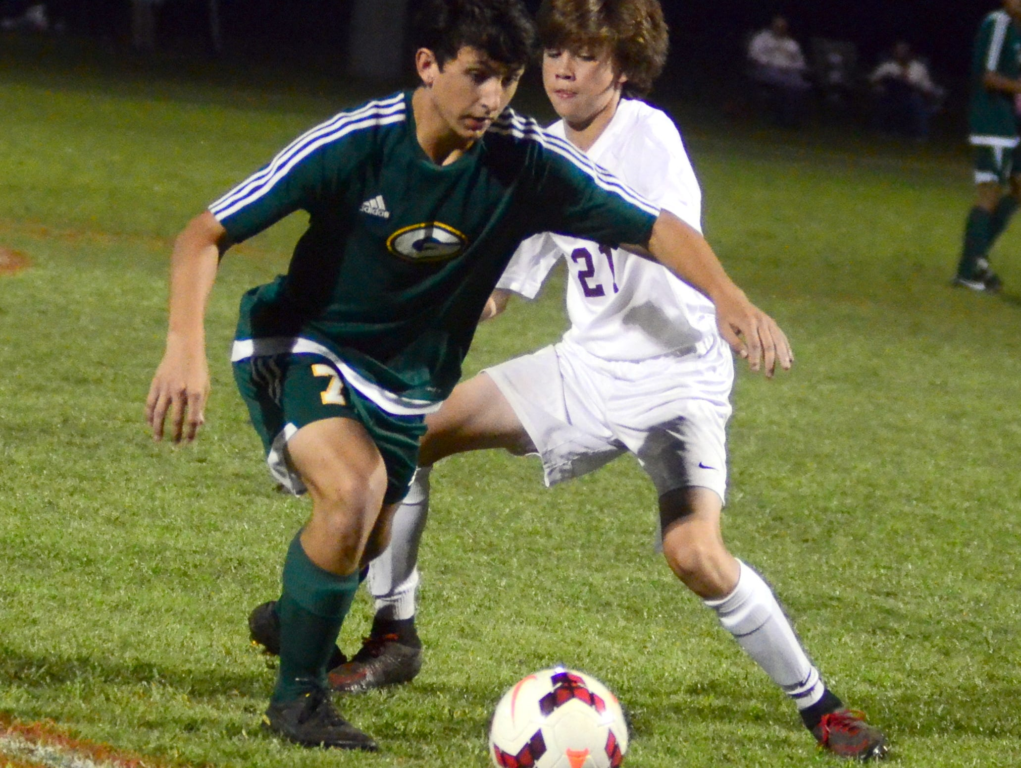 Gallatin High junior Noah Lawler maneuvers past Station Camp sophomore Caden McGranaghan during first-half action.