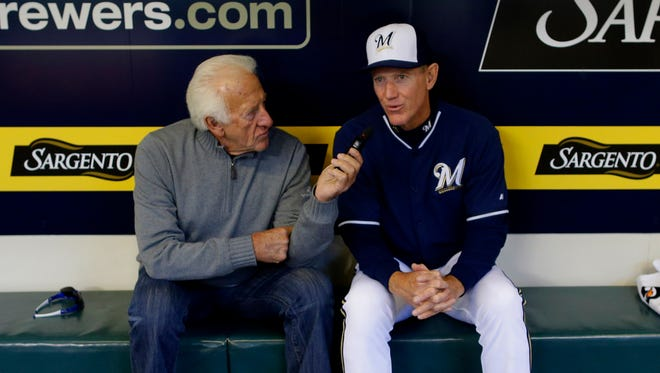 Bob Uecker interviews Brewers manager Ron Roenicke earlier this season.