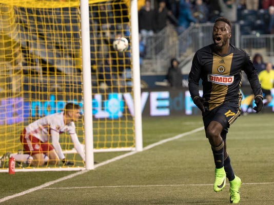 Philadelphia Union's C.J. Sapong, right, celebrates his goal with Toronto FC's Nick Hagglund, left, looking on from inside the goal during the second half of an MLS soccer match, Saturday, March 11, 2017, in Chester, Pa. The match ended in a 2-2 tie. (AP Photo/Chris Szagola)