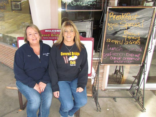 Stayton's Covered Bridge Cafe co-owners Cari Sessums, left, and Christy Sessums. This year on Thanksgiving eve the cafe will serve its 11th annual free community dinner. In 2015 they served 1,500 meals via delivery and sit-in dinners at the cafe.