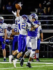 Germantown wide receiver Kyle Farina (20) can't make the catch with Waukesha West's Tyler Leitner (10) defending at West on Thursday, Sept. 7, 2017.