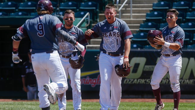 Jake Burger (9) is greeted at home plate by, from left, Hunter Steinmetz Justin Paulsen and John Privitera after his grand slam during the Bears' game against the Southern Illinois Salukis during the Missouri Valley baseball tournament at Hammons Field on Thursday, May 25, 2017.