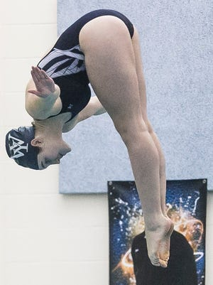 West York's Erica Sarver, takes her first dive of the prelims, during the YAIAA Diving Championship Wednesday, Feb. 8, 2017, at Central York Aquatic Center. Sarver, won the girls' championship. Amanda J. Cain photo