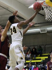 Alamogordo's Chamar Norman extends his arm out to make a layup Tuesday night.
