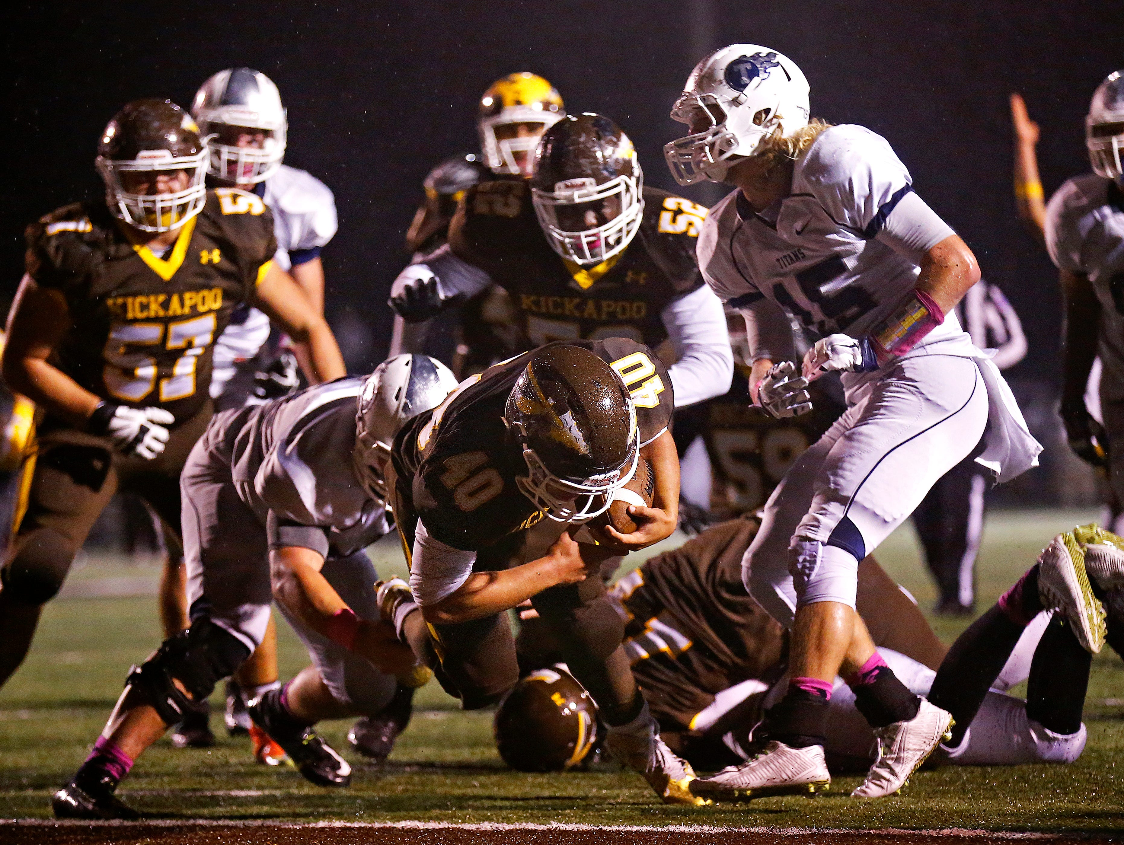 Kickapoo High School running back Malachi Stout (40) makes his way to the end zone for a touchdown during third quarter action of the Chiefs' game against Lee's Summit West High School at Pottenger Stadium in Springfield, Mo. on Oct. 30, 2015. Kickapoo won the game 26-7.