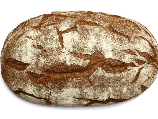 Oval brown bread loaf with distinctive texture