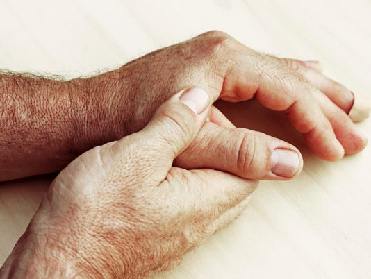 elderly man has pain in fingers and hands