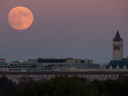 FILE -- The supermoon rises behind the Trump International