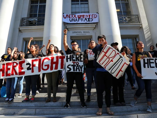 Latino students protest Donald Trump on the steps at Sproul Plaza at the campus of the University of California, Berkeley.