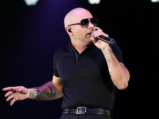 "Pitbull performs at the fourth annual ""We Can Survive"" Concert held at the Hollywood Bowl on Oct. 22, 2016, in Los Angeles. In 2015, a state agency, Visit Florida, hired Pitbull to do some tourism promotion. The hip-hop star was paid with public funds."