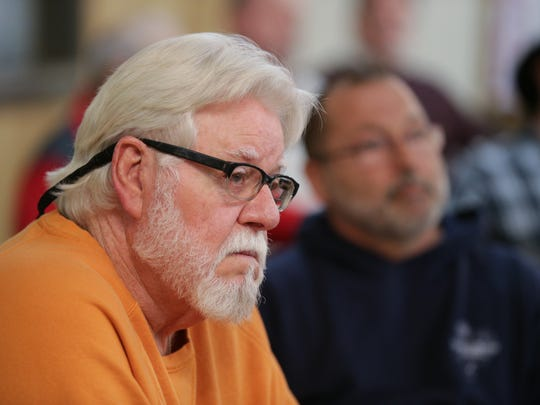 Teamster Ron Brown, with Local 414, listens to speakers during a meeting for the Central States Pension Fund at the American Legion Post 500 in Indianapolis, March 4, 2017.