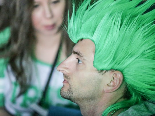 Mike Mclean celebrated St. Patrick's Day weekend at Tiki Bob's in downtown Indianapolis, March 18, 2017.  Revelers made their way through downtown Indy for the Indianapolis 2017 St. Pat's two day Bar Crawl, and NCAA Mens Basketball Tournament.