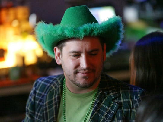 Corey Stasen celebrates St. Patrick's Day weekend at Tiki Bob's in downtown Indianapolis, March 18, 2017.  Revelers made their way through downtown Indy for the Indianapolis 2017 St. Pat's two day Bar Crawl, and NCAA Mens Basketball Tournament.