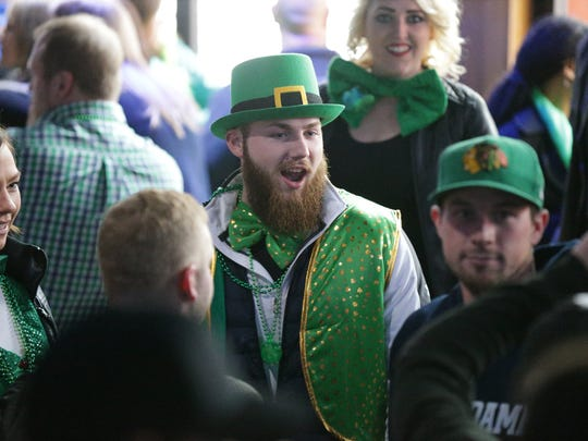 Revelers celebrate St. Patrick's Day weekend at Tiki Bob's in downtown Indianapolis, March 18, 2017.  Revelers made their way through downtown Indy for the Indianapolis 2017 St. Pat's two day Bar Crawl, and NCAA Mens Basketball Tournament.