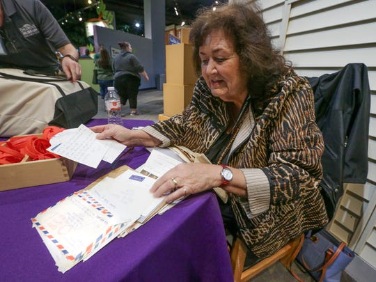 Jeanne White Ginder, the mother of AIDS activist Ryan White, shows some of the letters written to her son which inspired him to fight to live, April 1, 2017. White Ginder spoke about her son's impact in the Power of Children gallery at the Children' Museum of Indianapolis.