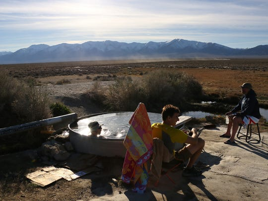 Daniel Ellsworth, left, Rick Gunn, middle, and Ben Spillman relax at Spencer Hot Springs after skiing in the Toiyabe Range in central Nevada on April 1, 2017.