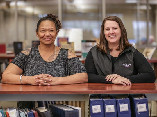 Life Coach for CareSource Life Services, Jessie Rockhill, meets with her client Leona Cullen at the Hamilton East Public Library in Noblesville Ind., April 28, 2017. The CareSource program has helped Cullen to find two jobs and her life coach is working to help her better her life overall.