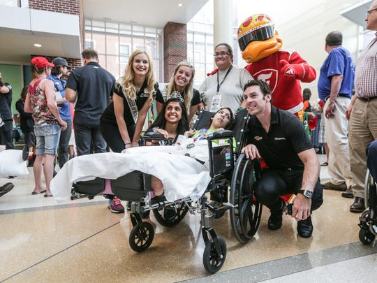 IndyCar driver Simon Pagenaud visits with a patient during Riley 500 pinewood derby race held at Riley Hospital for Children at IU Health, May 16, 2017.