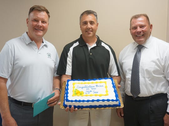 CRW owner Scott Wink (from left), Brian Schmitz and CRW Owner Brian Ruh recognize Schmitz on his 25 years with the company.