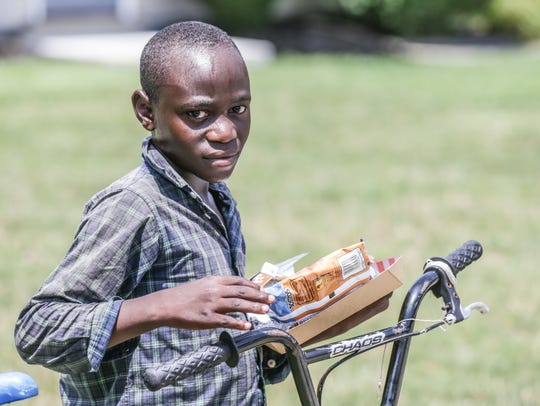 A child receives lunch from the Indianapolis Public
