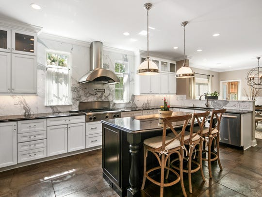 Entertainers can only dream about the elegant custom kitchen which opens up to spacious living and dining rooms.