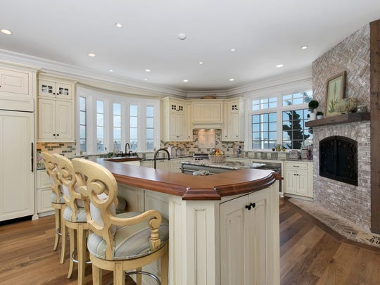 The Kitchen features two center island and huge fireplace.
