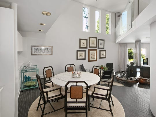 The dining room features recessed lighting and space