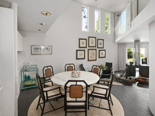 The dining room features recessed lighting and space for a 6-piece dinette set.