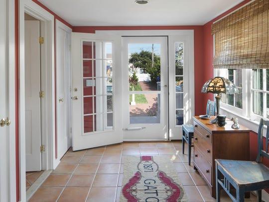 Foyer with ceramic tile flooring.