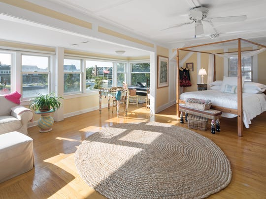 Master bedroom has private sitting area overlooking the lagoon.