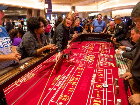 The craps table was plenty busy at the new land-based casino, Tropicana Evansville, which opened for the first time Friday morning.