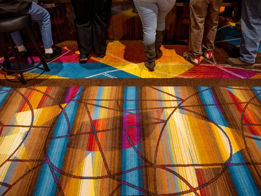 The bright, colorful carpets add to the eye-popping look of the new land-based casino, Tropicana Evansville, which opened for the first time Friday morning.