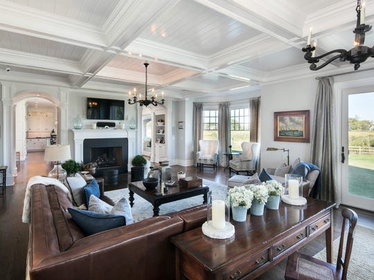 Living room features amazing decorative molding ceilings and a fireplace.