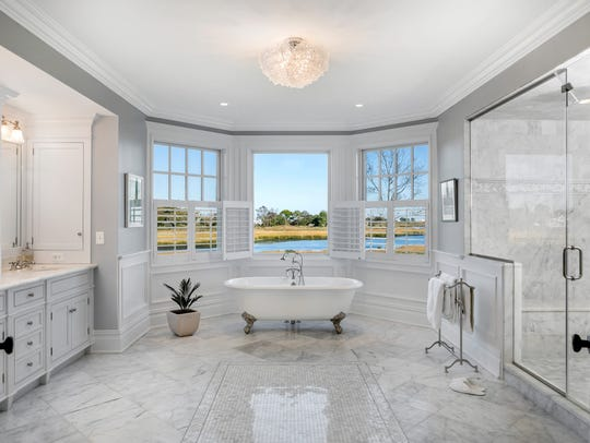 Master bathroom features double sinks, steam shower