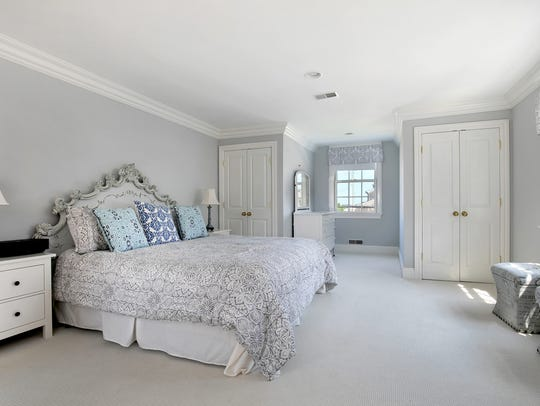 The master bedroom with his and her walk-in closets.