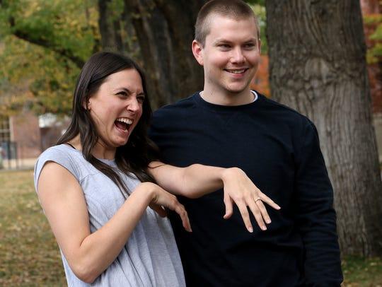 Dallin Knecht, right, surprises his girlfriend Sara
